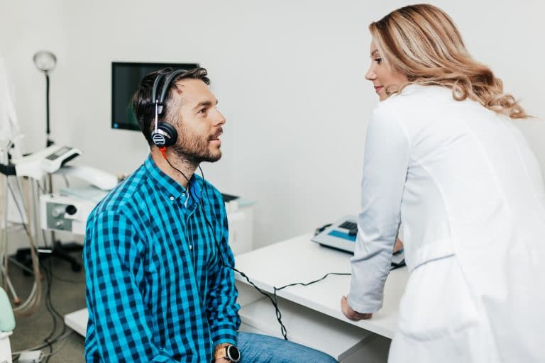 Man gets a hearing evaluation.